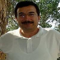 Dr. Enzar Töre